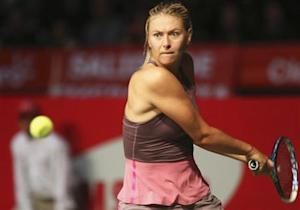 Russia's Sharapova returns a shot to Serbia's Ivanovic during exhibition in Bogota