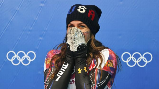 Noelle Pikus-Pace of the U.S. reacts after winning second place in the women's skeleton event at the 2014 Sochi Winter Olympics