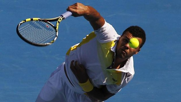 Jo-Wilfried Tsonga of France serves to compatriot Richard Gasquet during their men&#39;s singles match at the Australian Open tennis tournament in Melbourne (Reuters)