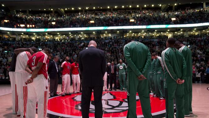 Toronto Raptors and Boston Celtics players observe a moment of silence for the victims of the Boston Marathon bombings before an NBA basketball game in Toronto, Wednesday April 17, 2013. (AP photo/The Canadian Press, Frank Gunn)
