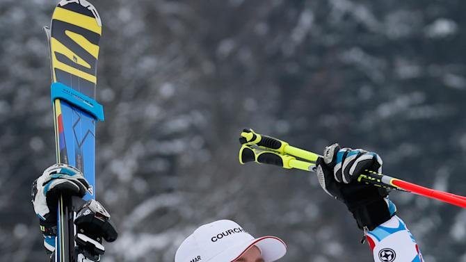 France's Alexis Pinturault celebrates after winning an alpine ski, men's world cup giant slalom in Garmisch-Partenkirchen, Germany, Sunday, Feb. 24, 2013. (AP Photo/Alessandro Trovati)