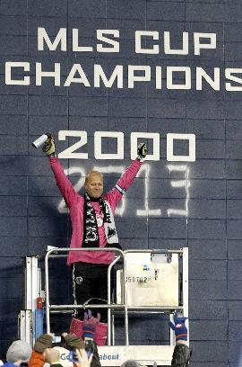 Sporting Kansas City goalkeeper Jimmy Nielsen acknowledges the fans after spray painting on the MLS Cup wall at Sporting Park after defeating Real Salt Lake in a shoot out in the MLS Cup final soccer