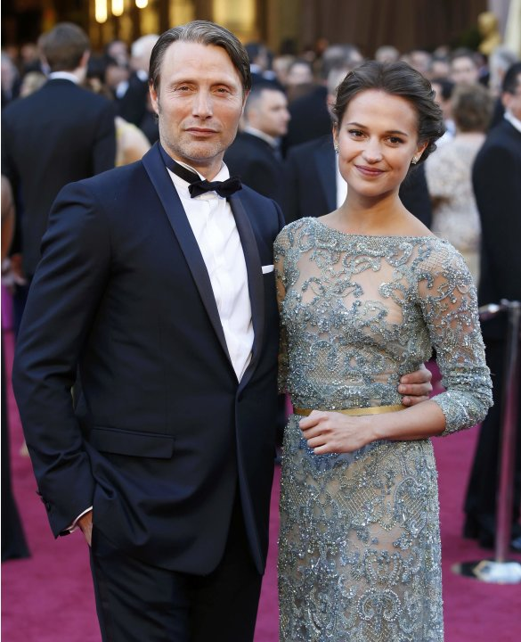 Mads Mikkelsen and daughter Viola Mikkelsen arrive at the 85th Academy Awards in Hollywood