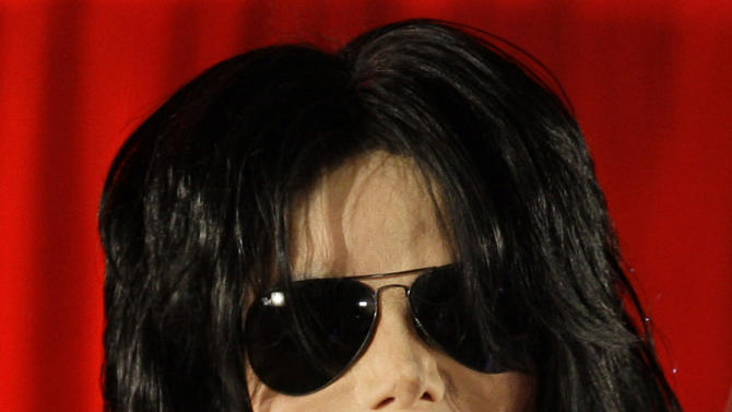 """FILE - In this March 5, 2009 file photo, US singer Michael Jackson announces that he is set to play ten live concerts at the London O2 Arena in July, which he announced at a press conference at the London O2 Arena. Some key figures who helped manage Michael Jackson's career are teaming up to create a musical about the behind-the-scenes making of a superstar that producers call a cross between """"Goodfellas"""" and """"Dreamgirls."""" """"The Man,"""" with a book by Lamica and Grammy Award-winning composer Hart, is expected to open in Las Vegas in the late fall of 2013. (AP Photo/Joel Ryan, File)"""