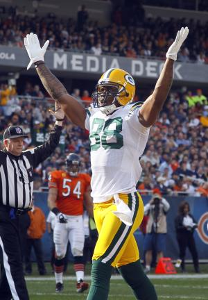 Green Bay Packers tight end Jermichael Finley celebrates after his 7-yard touchdown reception against the Chicago Bears in the first half of an NFL football game in Chicago, Sunday, Sept. 25, 2011. (AP Photo/Charles Rex Arbogast)