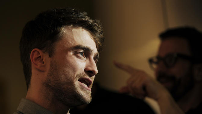 """Daniel Radcliffe, a cast member in the film """"What If,"""" is interviewed at IvyConnect's Innovator Film Awards at the Landmark Theatres on Wednesday, Aug. 6, 2014 in Los Angeles. (Photo by Chris Pizzello/Invision/AP)"""