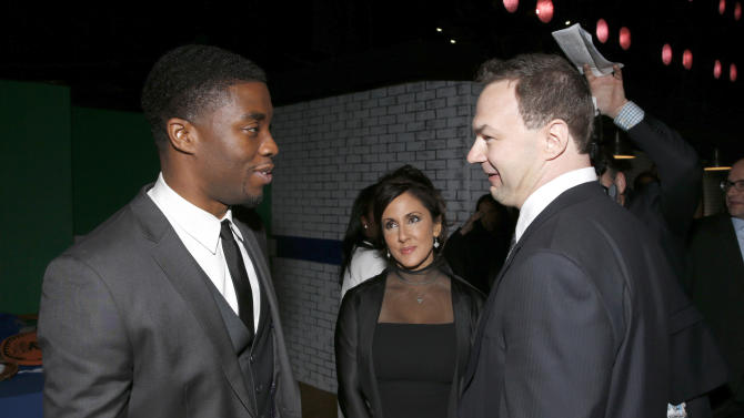 """Chadwick Boseman and Producer Thomas Tull attend the after party for the LA premiere of """"42"""" at the TCL Chinese Theater on Tuesday, April 9, 2013 in Los Angeles. (Photo by Todd Williamson /Invision/AP)"""