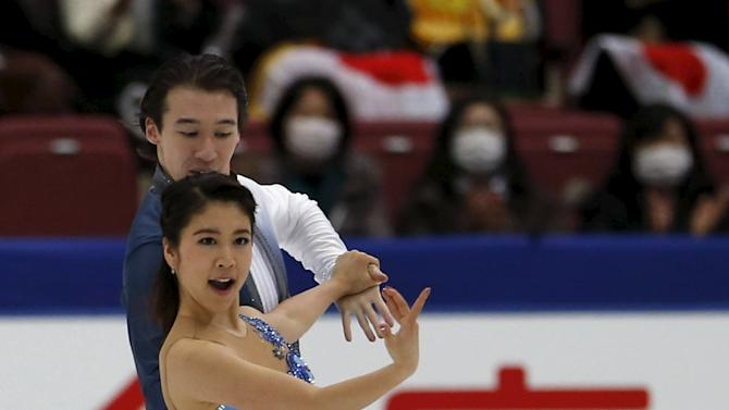 Kana Muramoto and Chris Reed of Japan perform during the ice dance short dance program at the ISU Grand Prix of Figure Skating in Nagano, Japan