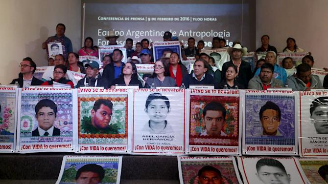 Members of the Argentine Team of Forensic Anthropology, relatives of the 43 students missing from Ayotzinapa College Raul Isidro Burgos and representatives of human rights organizations take part in a news conference in Mexico City