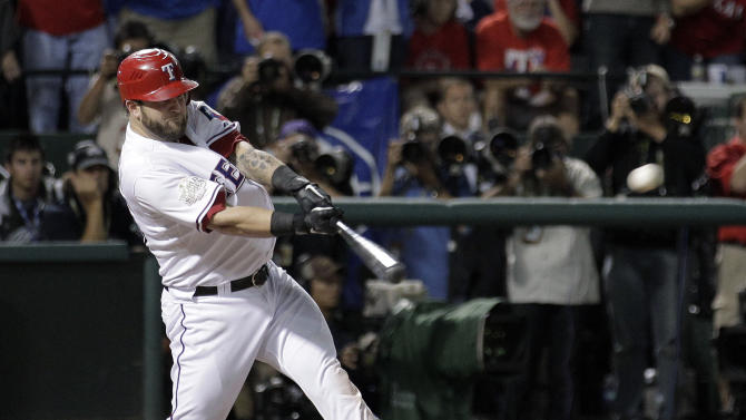 Texas Rangers' Mike Napoli hits a two-run double during the eighth inning of Game 5 of baseball's World Series against the St. Louis Cardinals Monday, Oct. 24, 2011, in Arlington, Texas. (AP Photo/Charlie Riedel)