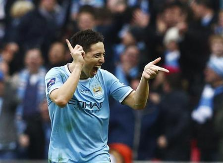 Manchester City's Samir Nasri celebrates after scoring a goal against Sunderland during their English League Cup final soccer match at Wembley Stadium in London March 2, 2014. REUTERS/Eddie Keogh