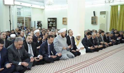Syria's President Bashar al-Assad attends Eid Al Fitr prayers at al-Hamad mosque in Damascus