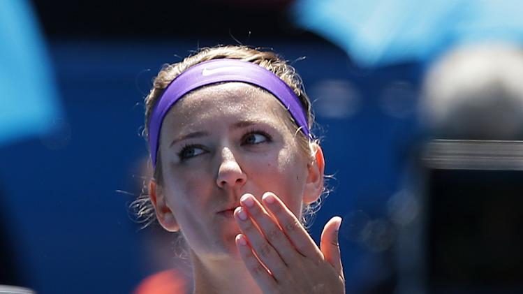Victoria Azarenka of Belarus blows kisses to the crowd following her fourth round victory over Russia's Elena Vesnina at the Australian Open tennis championship in Melbourne, Australia, Monday, Jan. 21, 2013. (AP Photo/Aaron Favila)