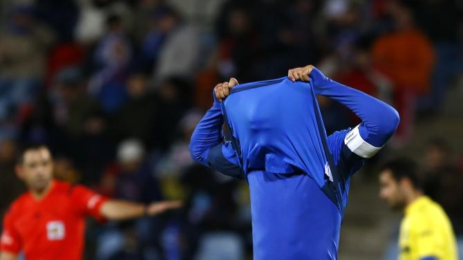 Getafe's Pedro Leon reacts after a missed opportunity against Villarreal during their Spanish King's Cup quarterfinal second leg soccer match in Getafe