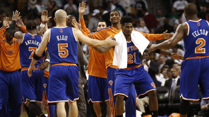 New York Knicks' Carmelo Anthony (7), Jason Kidd (5) and Raymond Felton (2) are congratulated by teammates including Iman Shumpert (21) while leaving the court during the fourth quarter of New York's 90-76 win over the Boston Celtics in Game 3 of a first round NBA basketball playoff series in Boston Friday, April 26, 2013. (AP Photo/Winslow Townson)