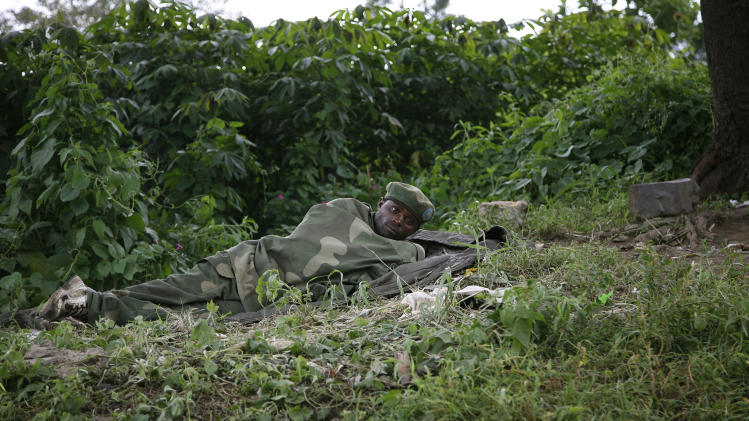 A Maimai fighter rests in his advanced position north of Minova - under government  control - on Sunday  Nov. 25, 2012.  Government troops remain in Minova, 25 kilometers (15 miles) south of Sake, following a failed attack on M23 last Thursday.Regional leaders meeting in Uganda called for an end to the advance by M23 rebels toward Congo's capital, and also urged the Congolese government to sit down with rebel leaders as residents fled some towns for fear of more fighting between the rebels and army.(AP Photo/Jerome Delay)