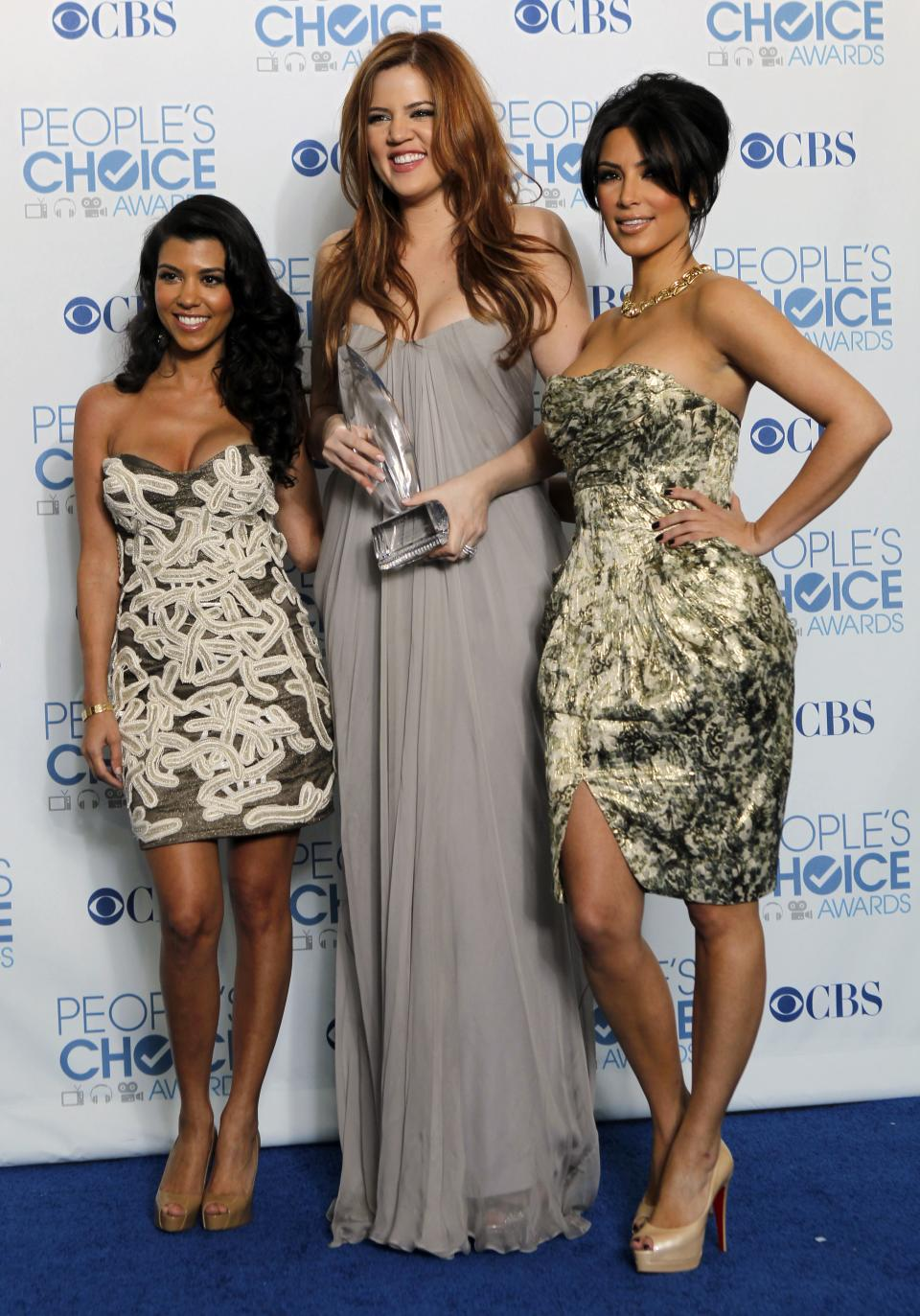 "From left, Kourtney Kardashian, Khloe Kardashian, and Kim Kardashian pose for a photo backstage with the award for favorite TV guilty pleasure for ""Keeping Up with the Kardashians"" at the People's Choice Awards on Wednesday, Jan. 5, 2011, in Los Angeles. (AP Photo/Matt Sayles)"