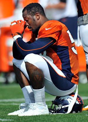 FILE - In this July 27, 2013, file photo, Denver Broncos linebacker Von Miller reacts as he sits on his helmet during NFL football training camp in Englewood, Colo. A person familiar with Miller's negotiations with the NFL tells The Associated Press that the linebacker will serve a six-game suspension under the league's substance-abuse policy. The league wanted a longer penalty, but the sides agreed to less than half the season. The person spoke to the AP on condition of anonymity on Tuesday, Aug. 20, 2013, because no official announcement had been made. (AP Photo/Jack Dempsey, File)