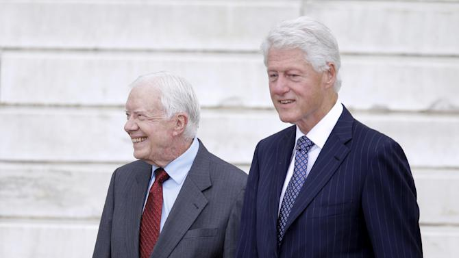 """Former Presidents Jimmy Carter and Bill Clinton arrive at the Let Freedom Ring ceremony at the Lincoln Memorial in Washington, Wednesday, Aug. 28, 2013, to commemorate the 50th anniversary of the 1963 March on Washington for Jobs and Freedom. It was 50 years ago today when Martin Luther King Jr. delivered his """"I Have a Dream"""" speech from the steps of the memorial. (AP Photo/Carolyn Kaster)"""