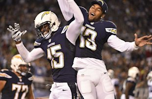 Keenan Allen and Dontrelle Inman, post-TD (AP Photo/Denis Poroy)