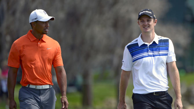 Tiger Woods, left, and Justin Rose, of England, walk to their next shot on the fairway during the second round of the Arnold Palmer Invitational golf tournament, Friday, March 22, 2013, in Orlando, Fla. (AP Photo/Phelan M. Ebenhack)