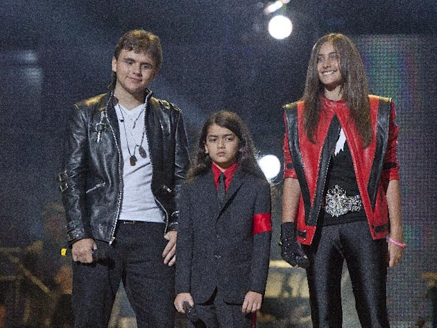 FILE - In this Oct. 8, 2011 file photo, from left, Prince Jackson, Prince Michael II &quot;Blanket&quot; Jackson and Paris Jackson arrive on stage at the Michael Forever the Tribute Concert, at the Millennium Stadium in Cardiff, Wales. TJ Jackson, one of Michael&#39;s favorite nephews, has been designated to work beside Michael&#39;s mother, Katherine, to look after the welfare of his three cousins Prince, 15, Paris, 14 and Blanket,10, who will inherit the King of Pop&#39;s fortune. (AP Photo/Joel Ryan, File) *Editorial Use Only*