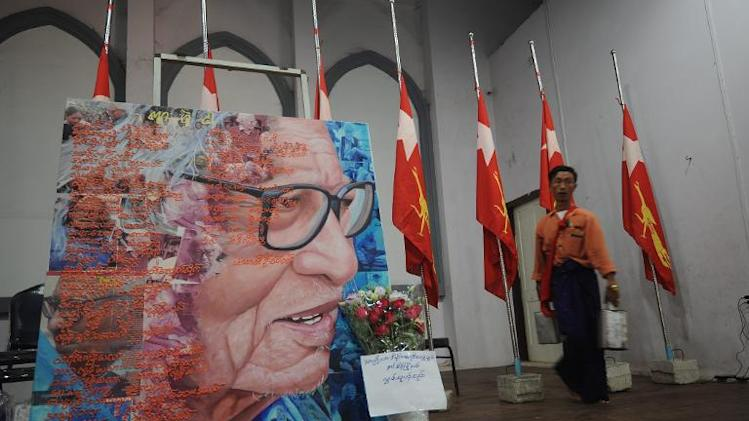 Members of National League for Democracy (NLD) prepare a memorial for Win Tin next to his portrait in Yangon on April 21, 2014