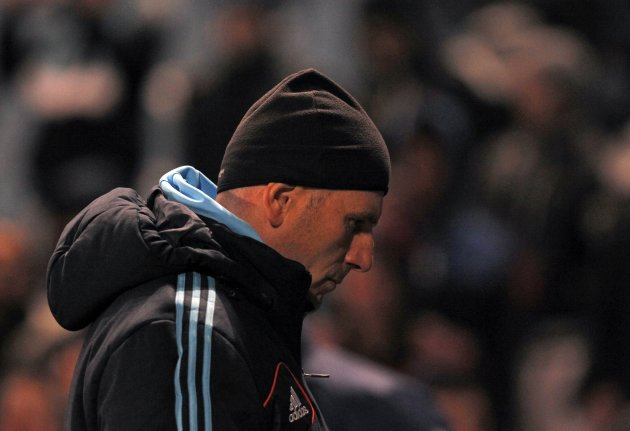 Olympique Marseille's head coach Baup leaves the pitch at the end of his match against Ajaccio during their French Ligue 1 soccer match at the Velodrome stadium in Marseille