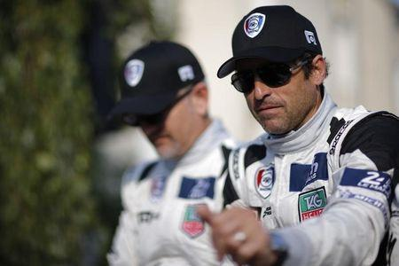 U.S. actor Dempsey gestures during a parade on the eve of the 82th 24-hours Le Mans endurance race in Le Mans