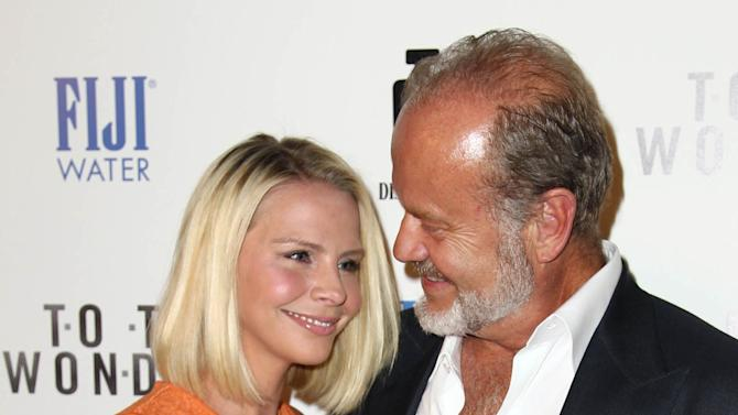 "Actor Kelsey Grammer, right, and Kayte Walsh arrive at the premiere of ""To The Wonder"" hosted by FIJI Water on Tuesday, April 9, 2013 in Los Angeles. (Photo by Matt Sayles/Invision for Fiji Water/AP Images)"