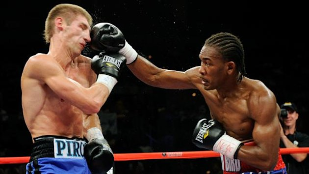 Daniel Jacobs (R) hits Dmitry Pirog in the third round of their bout at Mandalay Bay