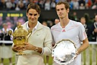 Switzerland's Roger Federer (L) poses with the trophy with loser Britain's Andy Murray (R) after his men's singles final victory on day 13 of the 2012 Wimbledon Championships tennis tournament at the All England Tennis Club in Wimbledon, southwest London. Federer won the match 4-6, 7-5, 6-3, 6-4