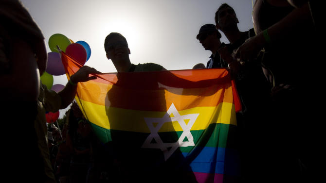FILE - In this file photo taken on June 25, 2009, Israelis march in the gay pride parade in Jerusalem. The Conservative Jewish seminary in Israel will be ordaining gay and lesbian rabbis, overcoming years of opposition by many of its own leaders and setting up a new point of contention between the movement and Israel's Orthodox establishment. (AP Photo/Bernat Armangue, File)