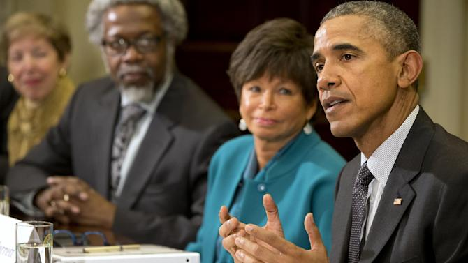 President Barack Obama sitting next to Senior Adviser Valerie Jarrett, and S. James Gates Jr., Director of the Center for String and Particle Theory at the University of Maryland, College Park, talks about antibiotic-resistant bacteria as he meets with members of the his Council of Advisers on Science and Technology, Friday, March 27, 2015, in the Roosevelt Room of the White House in Washington. (AP Photo/Jacquelyn Martin)