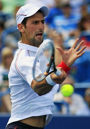 Novak Djokovic, from Serbia, hits a forehand shot against Juan Martin del Potro, from Argentina, during a semifinal match at the Western & Southern Open tennis tournament, Saturday, Aug. 18, 2012, in Mason, Ohio. (AP Photo/Al Behrman)