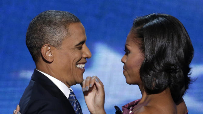 President Barack Obama hugs his wife Michelle before addressing the Democratic National Convention in Charlotte, N.C., on Thursday, Sept. 6, 2012. (AP Photo/J. Scott Applewhite)