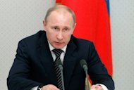 Russia's President Vladimir Putin answers questions during a press conference in the Black Sea resort of Sochi on July 2. Russia has denied holding talks with the United States about offering Syrian President Bashar al-Assad exile as a way out of 16 months of bloodshed that has claimed more than 16,500 lives