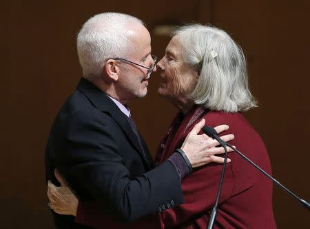 Roberta Buffett Elliott hugs Northwestern University President Morton Schapiro at an announcement ceremony in Evanston