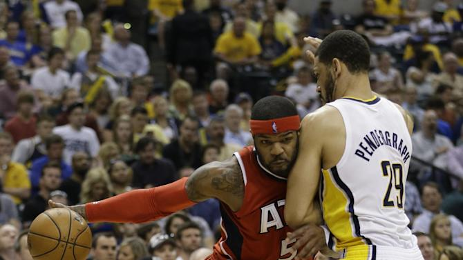 Atlanta Hawks' Josh Smith (5) goes to the basket against Indiana Pacers' Jeff Pendergraph (29) during the first half of Game 5 in the first round of the NBA basketball playoff series on Wednesday, May 1, 2013, in Indianapolis. (AP Photo/Darron Cummings)
