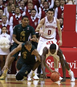 Michigan State's Adreian Payne (5) and Indiana's Hanner Mosquera-Perea (12) battle for a loose ball during the first half of an NCAA college basketball game on Sunday, Jan. 27, 2013, in Bloomington, Ind. (AP Photo/Darron Cummings)