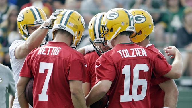 Rodgers getting used to new receivers at camp