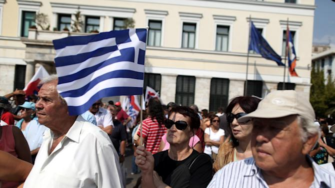 A Pensioners holds a Greek flag during a rally against healthcare cuts, in Athens, on Saturday, Sept. 8, 2012. Greece, in the grip of a severe recession for the fifth straight year, is still struggling to avoid bankruptcy by imposing harsh austerity measures, including wage and pension cuts, with unemployment increasing to nearly a quarter of the workforce.(AP Photo/Petros Giannakouris)