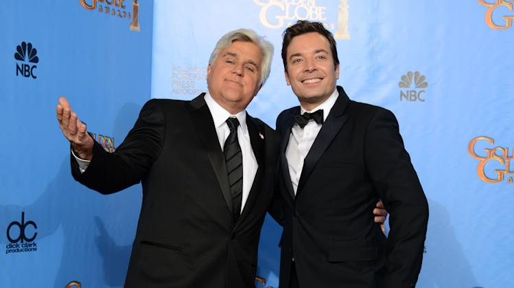 "FILE - This Jan. 13, 2013 file photo shows Jay Leno, host of ""The Tonight Show with Jay Leno,"" left, and Jimmy Fallon, host of ""Late Night with Jimmy Fallon"" backstage at the 70th Annual Golden Globe Awards in Beverly Hills, Calif. Leno and Jimmy Fallon poked fun at the late-night rumors swirling around them in a music video that aired between their back-to-back NBC shows on Monday, April 1. In a spoof of the romantic ballad ""Tonight"" from ""West Side Story,"" Leno, who was backstage at the ""Tonight"" show on the West Coast, and Fallon, in his ""Late Night"" office in Manhattan, serenaded each other by cellphone. (Photo by Jordan Strauss/Invision/AP, file)"