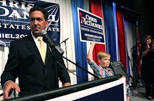 Chris McDaniel addresses his supporters as his son Cambridge, 7, joins him on the stage Tuesday June 3, 2014, at the Lake Terrace Convention Center in Hattiesburg, Miss. It could be days or weeks before the results of the Mississippi Republican Senate primary between six-term incumbent Thad Cochran and McDaniel. The race was too close to call on election night Tuesday. With a third candidate on the ballot, neither Cochran nor McDaniel managed to get at least 50 percent plus one vote, the threshold to win outright and avoid a June 24 runoff. (AP Photo/George Clark)