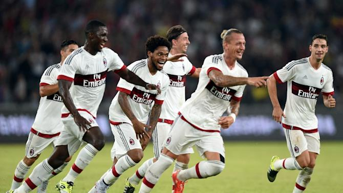 AC Milan players celebrate with defender Philippe Mexes (2nd R) after he scores during the International Champions Cup match against Inter Milan in Shenzhen on July 25, 2015