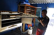 Jose Galdamez, of the Barrio 18 gang, makes bread at a bakery they operate in Ilopango, El Salvador on January 21, 2012. They opened their bakery two weeks ago in a small house in the blue-collar neighborhood, where a sign reads &quot;18 Welcome&quot;
