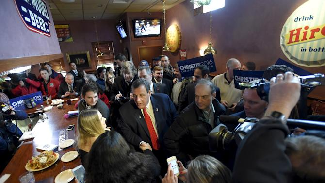 U.S. Republican presidential candidate and New Jersey Governor Chris Christie shakes hands at T-Bones Great American Eatery in Derry,