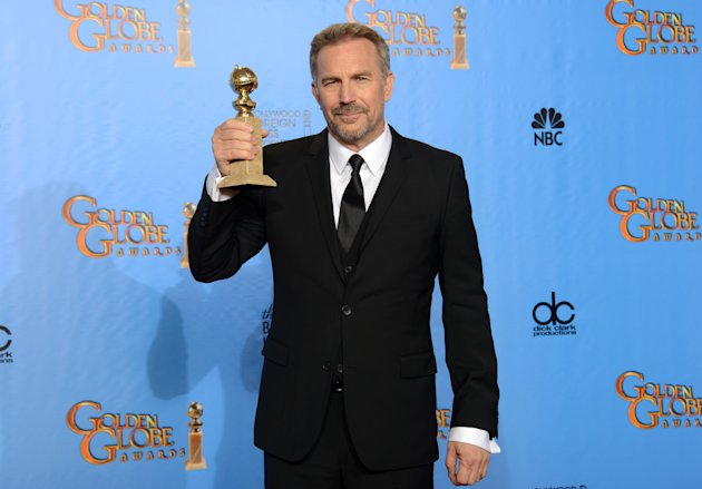 Kevin Costner poses with the award for best performance by an actor in a mini-series or a motion picture made for television for &quot;Hatfields & McCoys&quot; backstage at the 70th Annual Golden Globe Awards at the Beverly Hilton Hotel on Sunday Jan. 13, 2013, in Beverly Hills, Calif. (Photo by Jordan Strauss/Invision/AP)