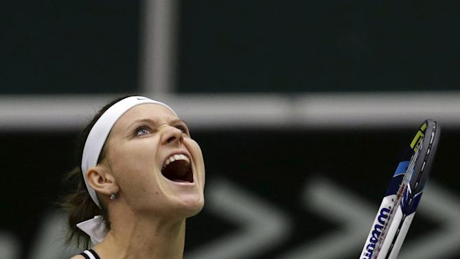 Czech Republic's Lucie Safarova celebrates after winning against France's Caroline Garcia during their semi-final match of the Fed Cup tennis tournament in Ostrava