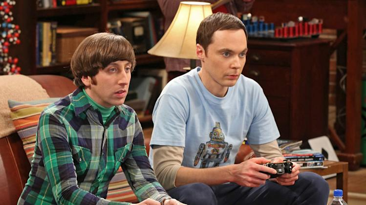 "This image released by CBS shows Jim Parsons, right, and Simon Helberg in a scene from ""The Big Bang Theory."" Parsons was nominated for an Emmy Award for best actor in a comedy series on, Thursday July 18, 2013. The Academy of Television Arts & Sciences' Emmy ceremony will be hosted by Neil Patrick Harris. It will air Sept. 22 on CBS. (AP Photo/CBS, Michael Yarish)"